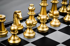 Gold chess pieces. stock photo