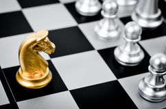 Gold chess pieces. stock photography