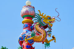 Gold chinese dragon. Statue wiggle on top Stock Photo