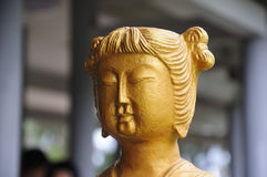 Gold Chinese girl statue Stock Images