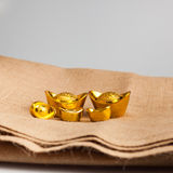 Gold Chinese ingot (Yuan Bao) place on gunny. Sack with copy space - best for Chinese New Year use Royalty Free Stock Image