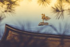 Gold Chinese phoenix bird on roof that covered white snow of Golden Pavilion at Kinkakuji Temple. Gold Chinese phoenix bird on roof that covered white snow of royalty free stock photography