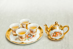 Gold chinese tea set Royalty Free Stock Photos