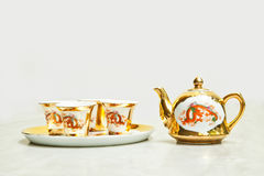 Gold chinese tea set Royalty Free Stock Images