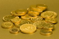 Gold Chocolate Coins. Set against a gold background Stock Photography