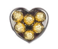 Gold chocolate in heart shape box isolated on white Royalty Free Stock Photography