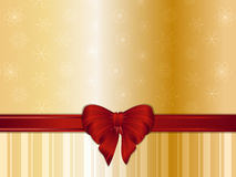 Gold Christmas background and bow. Gold Christmas background snowflakes, ribbon and bow Royalty Free Stock Images