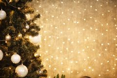 Gold Christmas background of de-focused lights with decorated tree 2018 stock photography