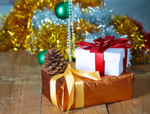 Gold Christmas background of de-focused lights with decorated tree Stock Photo