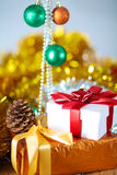 Gold Christmas background of de-focused lights with decorated tree Royalty Free Stock Images