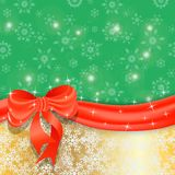 Gold Christmas background with ribbon and bow. Royalty Free Stock Photography