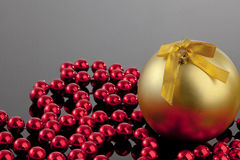 Gold Christmas Ball. And beeds. Ideal for Christmas cards Royalty Free Stock Photo