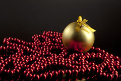 Gold Christmas Ball. On black background Royalty Free Stock Photos