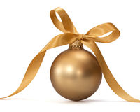 Gold Christmas ball. With ribbon over white background Royalty Free Stock Image
