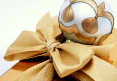 Gold Christmas Ball And Bow Royalty Free Stock Image