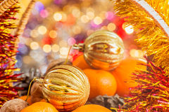 Gold Christmas ball in the basket with fruits and nuts Royalty Free Stock Photos