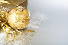 Gold christmas ball and gift Stock Images