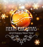 Gold Christmas ball on a holiday background Stock Photo
