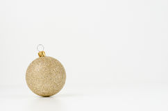Gold Christmas ball. Isolated on white background Stock Photos