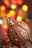 Gold christmas ball over blurred colorful background Stock Photography