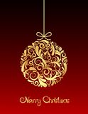 Gold Christmas ball on red background. Stock Photos