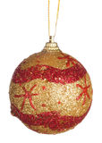 Gold christmas ball with red ornament Royalty Free Stock Photos