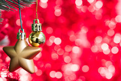 Gold christmas ball and star ornament decorate on fir tree Royalty Free Stock Photo