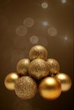 Gold Christmas balls. The pyramid of  the Gold Christmas balls Royalty Free Stock Photography