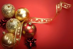 Gold Christmas balls. Christmas balls in red background Royalty Free Stock Photo