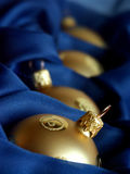 Gold christmas balls. In blue box Royalty Free Stock Photography
