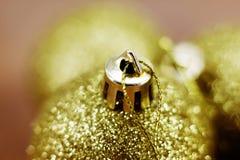 Gold Christmas balls Stock Photos