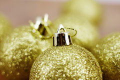 Gold Christmas balls. Gold Christmas ball bokeh effect Stock Photos