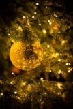 Gold christmas balls with christmas tree Stock Photos