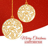 Gold Christmas balls decorated with a delicate pattern Royalty Free Stock Photo