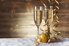 Gold Christmas balls. With glass of fizz Royalty Free Stock Photos