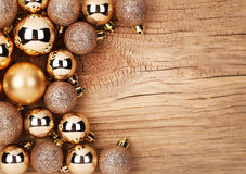 Gold Christmas Balls Over Wooden Background Stock Photos