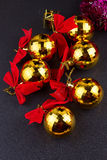 Gold Christmas balls with red ribbons Royalty Free Stock Photography