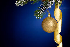 Gold Christmas balls and ribbon Royalty Free Stock Image