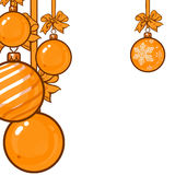 Gold Christmas balls with ribbon and bows Royalty Free Stock Images