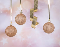 Gold Christmas Balls and Ribbon Stock Image