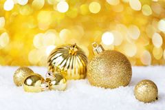 Gold Christmas balls on the shiny background. Very shallow depth of field. Selective focus Stock Images
