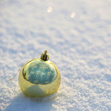 Gold Christmas Balls on Snow. Outside. Royalty Free Stock Image