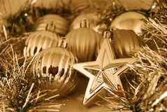 Gold Christmas balls and stars. Decorations - background Stock Photo
