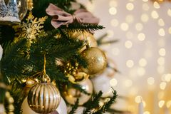Gold Christmas balls on the tree royalty free stock photography