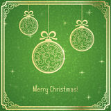 Gold Christmas Balls, With Swirl Pattern And Shiny On Green Background. Royalty Free Stock Photos