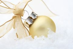 Gold Christmas bauble decoration with ribbon. Stock Images