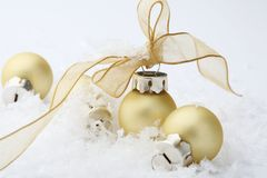Gold Christmas bauble decorations with ribbon. Stock Photos