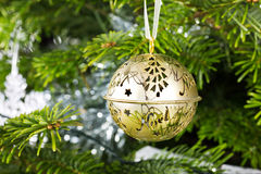 Gold Christmas bauble hanging on a Christmas tree Stock Photo