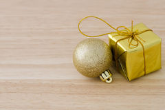 Gold Christmas bauble and Present Box Royalty Free Stock Photo