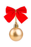 Gold Christmas bauble with red bow. Isolated Royalty Free Stock Photo